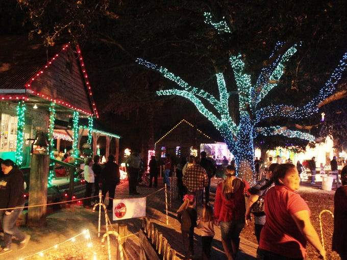 ... Christmas at Acadian Village. Visitors enjoy the sights and sounds of Noel Acadien