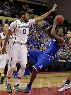 Michigan State forward Marvin Clark Jr. (0) guards against Kansas guard Wayne Selden Jr. (1) during the first half of an NCAA college basketball game in Lake Buena Vista, Fla., Sunday, Nov. 30, 2014. (AP Photo/Reinhold Matay)