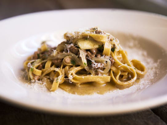 Farro tagliatelle with seared chicken livers, onions