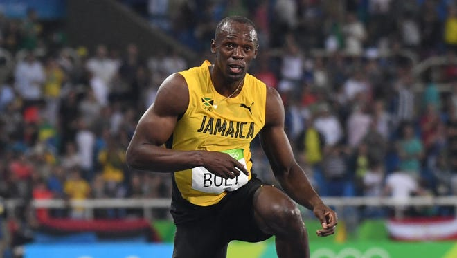 Usain Bolt reacts as he wins gold in the men''s 200-meter final.