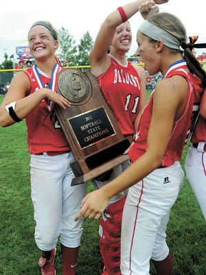 Ballard's (from left) Kenzie Ihle, Brooke Mallon and Annie Stolte celebrate with the Class 3A state championship trophy after winning 5-4 over Solon in the 3A state softball championship game July 20, 2012 at Rodgers Sports complex in Fort Dodge. Ihle hit a dramatic three-run homer in the bottom of the sixth inning to put Ballard up and Mallon made a tag at the plate for the final out to give Ballard it's first and thus far only state softball championship. File photo by Nirmalendu Majumdar/Ames Tribune.