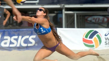 FGCU and Canterbury School graduate Brooke Sweat favors her injured right shoulder during an FIVB World Series of Volleyball match Aug. 19 in Long Beach, California.