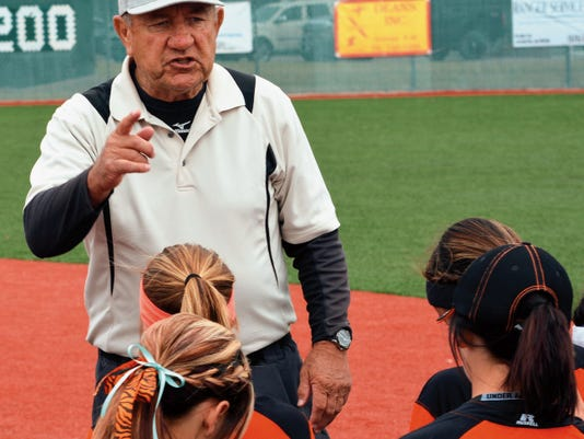 Matt Hollinshead — Current-Argus Former Artesia softball coach John Tigert talks to players right after they beat Deming at the Lady Dog Invite tournament semifinals Saturday, April 4. Tigert was named Carlsbad's head softball coach.