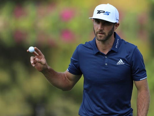 Dustin Johnson, of the United States, shows the ball after hitting at the 17th hole green during the final round of the Mexico Championship at Chapultepec Golf Club in Mexico City, Sunday, March 5, 2017. Johnson won the Mexico Championship in his debut as the No. 1 player in the world. (AP Photo/Christian Palma)
