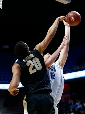 Purdue center A.J. Hammons (20) blocks the shot of Old Dominion center Payton Pervier (12) during the second half at Mohegan Sun Arena.