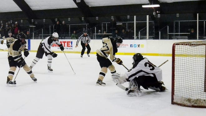 Scarsdale goalie Sam Seltzer stops Adam Marvin on a second-period breakaway. The sophomore made 30 saves in a 2-0 win over Clarkstown on Sunday at E.J. Murray Skating Center.