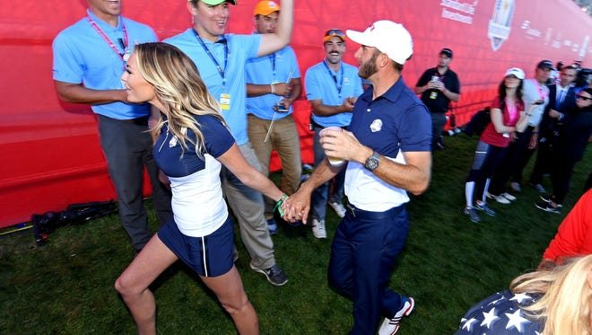 Dustin Johnson and Paulina Gretzky celebrate the U.S.' Ryder Cup win.