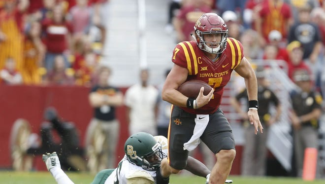 Iowa State quarterback Joel Lanning gets tripped up by a Baylor defender as he runs to a first down Saturday, Oct. 1, 2016, at at Jack Trice Stadium in Ames.