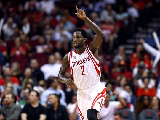 Patrick Beverley reacts after making a basket during