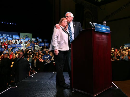 Jane O'Meara Sanders gets a kiss on the head from her husband, Democratic presidential candidate Sen. Bernie Sanders, at a campaign rally Monday in Atlantic City.