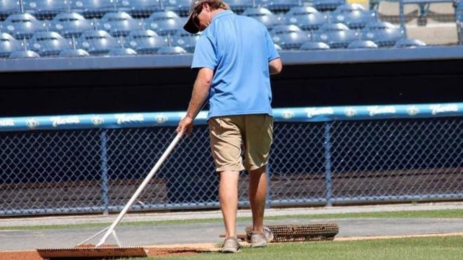 A staff member works on the infield at McCormick Field in this file photo.