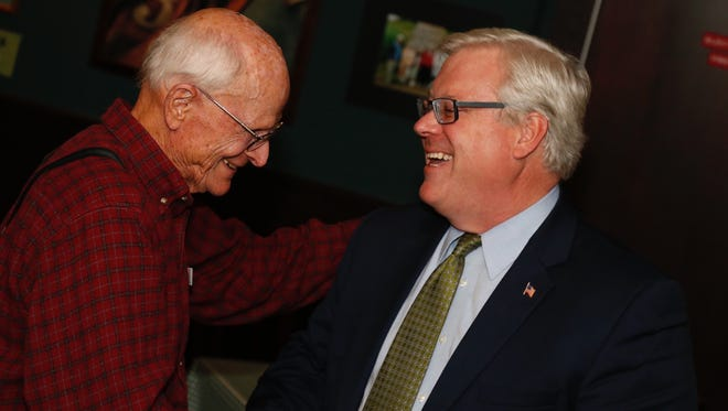 Sen. Tom O'Mara is all smiles as he shakes the hands of his supporters after being re-elected to his seat in New York's 58th Senate District on Tuesday inside Bernie Murray's on Elmira's Southside.  Republican incumbent Tom O'Mara secured a fourth term in the race for New York's 58th Senate District. against