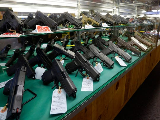 Guns displayed for sale Tuesday at Central Wisconsin Firearms in downtown Wausau.