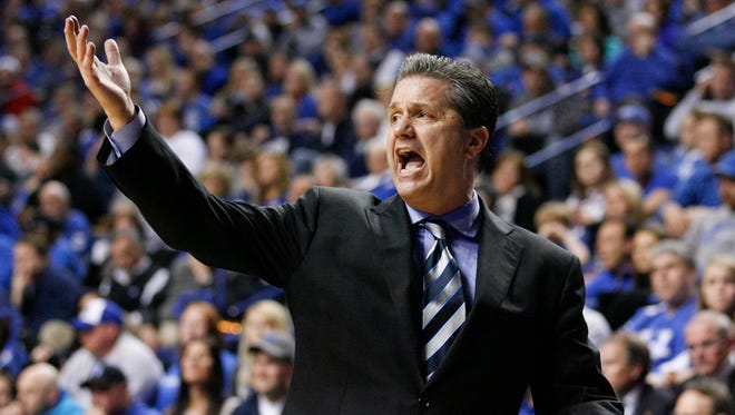 Kentucky Wildcats head coach John Calipari reacts to a play during the game against the Alabama Crimson Tide in the second half at Rupp Arena.