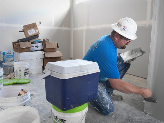 Dan Lintzenich working on the dry wall in what will become the Vanderburgh County Sheriff's criminal investigation office in the new sheriff's command building under construction next to the administration office on N. Harlan Avenue in Evansville Tuesday, June 13, 2017.