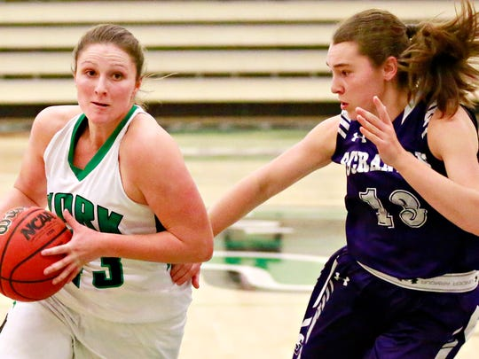 York College's Katie Wagner, left, advances the ball while Scranton's Bridgette Mann defends during women's basketball action at Grumbacher Sport and Fitness Center in Spring Garden Township, Wednesday, Dec. 13, 2017. Scranton would win the game 67-63.  Dawn J. Sagert photo