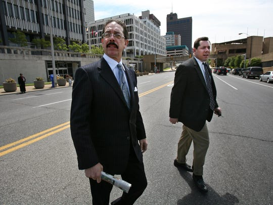 April 9, 2007 - Former state senator John Ford leaves the Federal Building with his attorney.