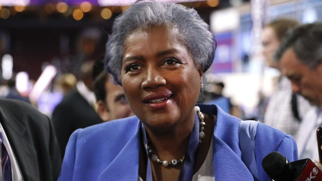 """FILE - In this July 25, 2016 file photo, Donna Brazile, interim chair of the Democratic National Committee, appears on the floor of the Democratic National Convention in Philadelphia. CNN says it is """"completely uncomfortable"""" to learn through WikiLeaks that Brazile had contacted the Clinton campaign ahead of time about a question that would be posed during a presidential primary town hall last March in Flint, Mich. CNN announced Monday, Oct. 31, that it had accepted Brazile's resignation as a contributor two weeks ago. Her deal had been suspended in July when she became interim head of the Democratic National Committee. (AP Photo/Paul Sancya, File)"""