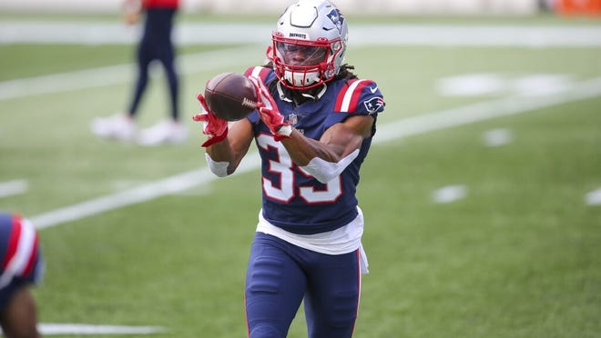 Patriots safety Kyle Dugger catches a ball while warming up for the Patriots' season opener against the Dolphins.