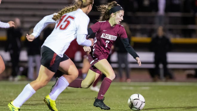 Junior Caroline Kelly, right, is one of four returning starters for the Algonquin Regional girls' soccer team.