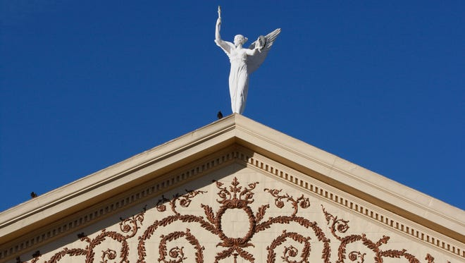 """156545 State Capitol -- 01/07/2009 -- """"Winged Victory"""" stands on the top of the Capitol's copper dome at the Arizona Capitol in Phoenix, AZ.  (Rob Schumacher/The Arizona Republic)"""