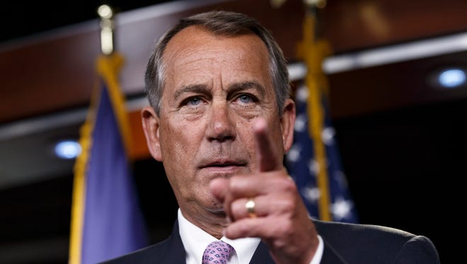 House Speaker John Boehner of Ohio meets with reporters on Capitol Hill in Washington, Thursday, Dec. 4, 2014.
