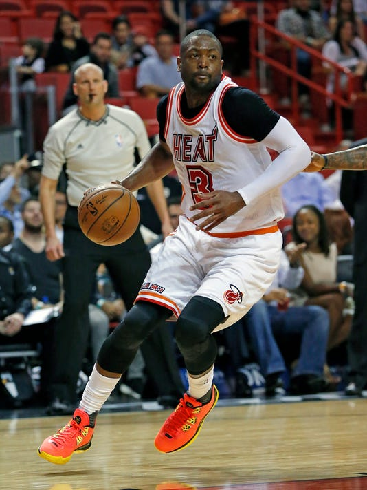 Miami Heat's Dwyane Wade (3) dribbles the ball as he goes to the basket  against the Indiana Pacers during the first half of an NBA basketball game, Monday, Feb. 22, 2016, in Miami. (AP Photo/Joel Auerbach)