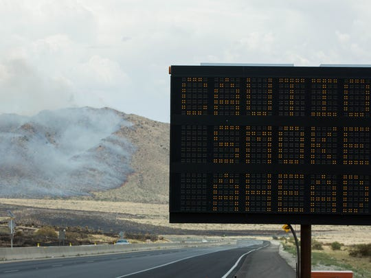 A digital sign warns motorists of smoke ahead on US