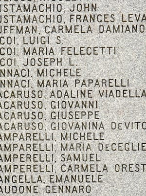 Italian American names on the Italian American monument near Chelsea Parade in Norwich Monday.