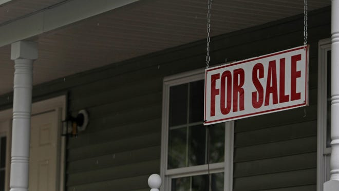 A for sale sign in Goshen. The state is allowing real estate professionals to use video equipment to give virtual tours to the prospective buyers and renters of homes and commercial sites.