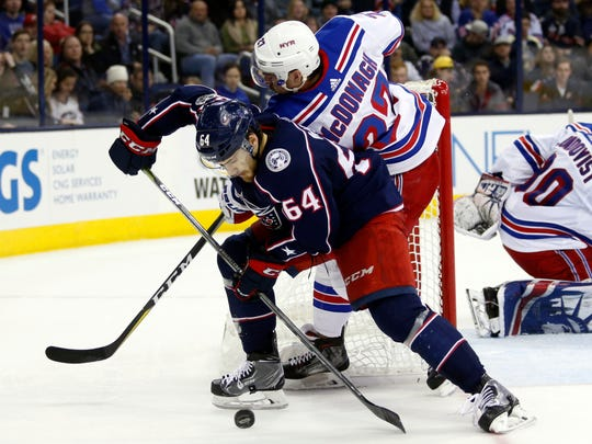 Columbus Blue Jackets forward Tyler Motte, left, works against New York Rangers defenseman Ryan McDonagh during the second period of an NHL hockey game in Columbus, Ohio, Friday, Nov. 17, 2017. (AP Photo/Paul Vernon)