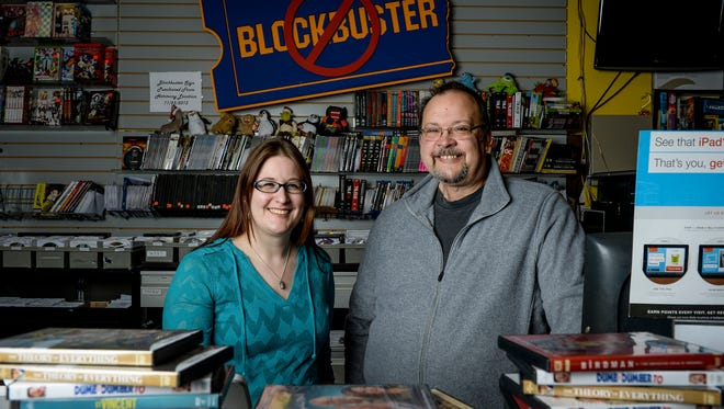 Kira Dunn, left, and her father, Scott Shepherd, in The Village Vidiot, the last video rental store in Fort Collins, which has outlasted the big chains.