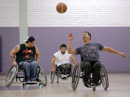 David Aguayo catches a pass up court as he and other wheelchair basketball players practice for the game between the El Paso Air Wheelers and the Las Cruces Rollers on October, 3.