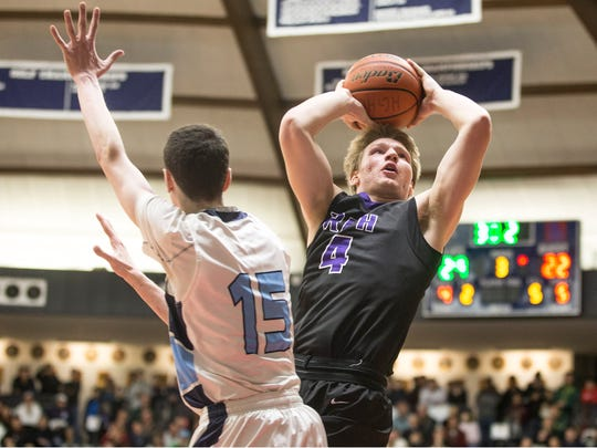 RFH's Ian O'Connor goes to the hoop.  Rumson-Fair Haven vs Christian Brothers Academy game of the Boardwalk Showcase Tournament at Brookdale Community College.   