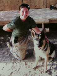 Marine Cpl. Megan Leavey with her dog, Rex, serving