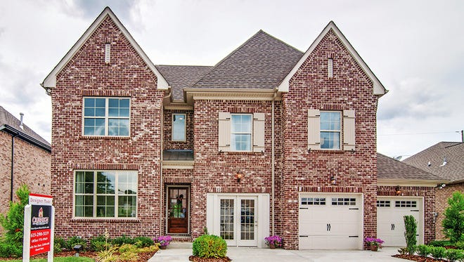 The Oxford II design at Canterbury features hardwood floors, vaulted ceilings, a large bonus room and two-car garage.