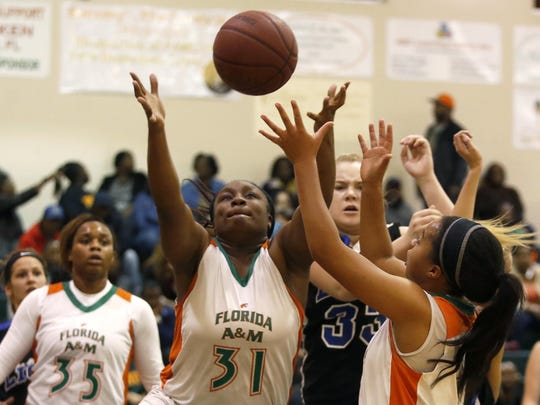 FAMU DRS senior Abriel Scott, center, goes after a rebound against Hernando Christian during their Region 1-2A final on Saturday. Scott had 11 rebounds and four points in the Rattlers' 85-12 win.