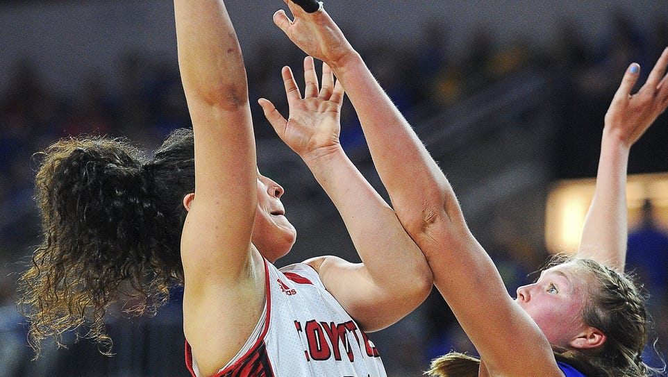 USD's Kate Liveringhouse (34) takes a shot over SDSU's
