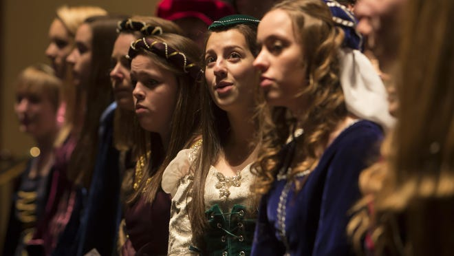 The Lourdes High School Madrigal Singers perform at the Grand Opera House for a holiday sing-along event in December 2013.