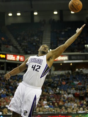 Sacramento Kings forward Chuck Hayes goes after a rebound during the first quarter of an NBA preseason basketball game  against the Los Angeles Clippers in Sacramento, Calif., Monday, Oct. 14, 2013.  The Kings won 99-88.(AP Photo/Rich Pedroncelli)