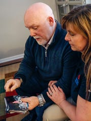 Gar and Lisa King sift through childhood photos of