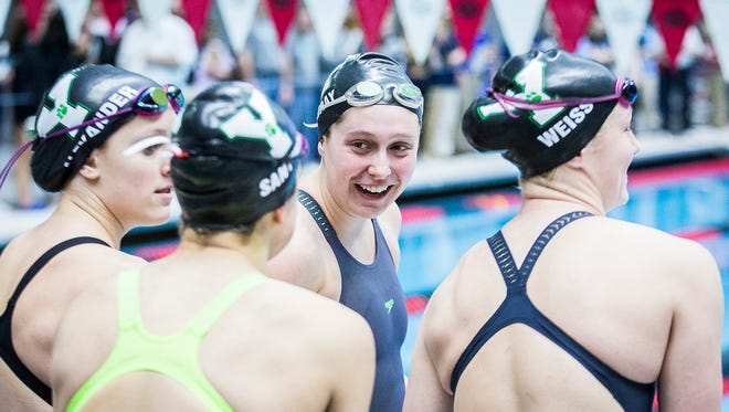 FILE -- Yorktown swimming and diving athletes compete in the State Championship consolation medley relay at the IU Natatorium Saturday, Feb. 10, 2018.