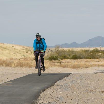 A bicyclist, rides toward Lohman Avenue on the newly