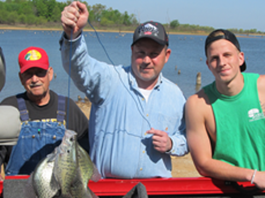 A three generation of crappie fishermen all caught