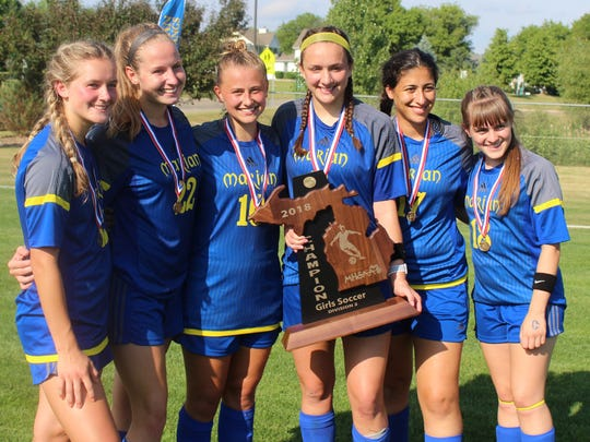 Marian seniors (left to right) Grace Kinna, Emme Deconinck, Claudia Schilling, Annie Bruce, Rayya Harb and Julia Surratt pose with the 2018 Division 2 state championship trophy Saturday in Williamston.