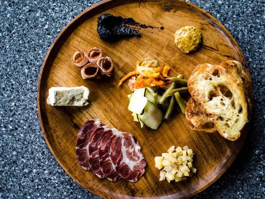 Dark Roux's charcuterie board includes house-cured meats, local cheese, preserves, mustard and ciabatta toast.