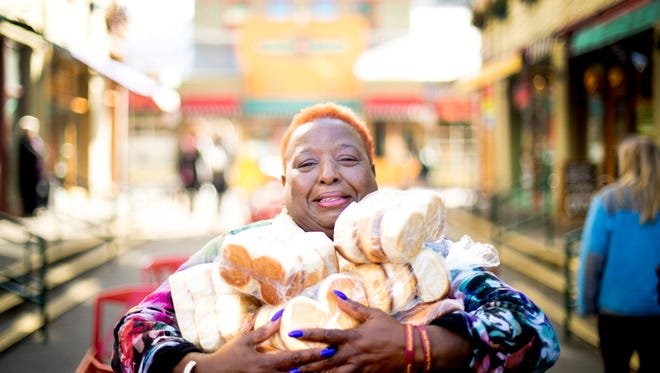 Alicia Jackson of Nay Nay's in Findlay Market holds her yeast dinner rolls.