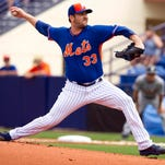 Mets pitcher Matt Harvey delivers a pitch against the Tigers during a spring training game Friday.