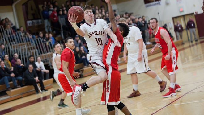 Danny Duffy, 10, goes in for a 2 point shot in the Section 1 Class AA first round playoff game at Arlington High School in Arlington on Feb. 18, 2017.