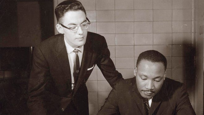 Dr. Martin Luther King signs a registry of speakers at the Wisconsin Memorial Union in 1962 when he spoke on the University of Wisconsin-Madison campus.